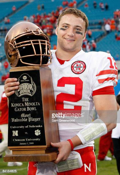 Quarterback Joe Ganz of the Nebraska Cornhuskers holds the MVP trophy following the Konica Minolta Gator Bowl against the Clemson Tigers at...