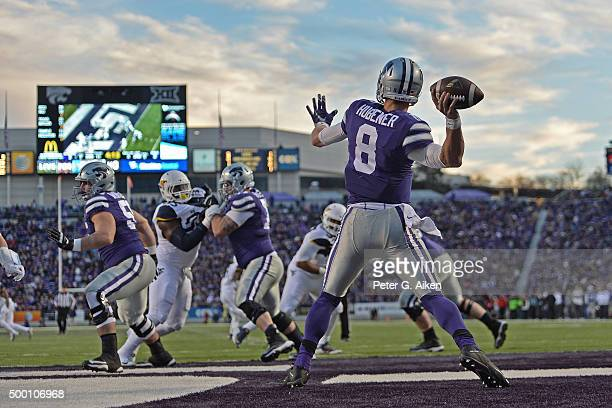 Quarterback Joe Hubener of the Kansas State Wildcats drops back to pass against the West Virginia Mountaineers during the first half on December 5...