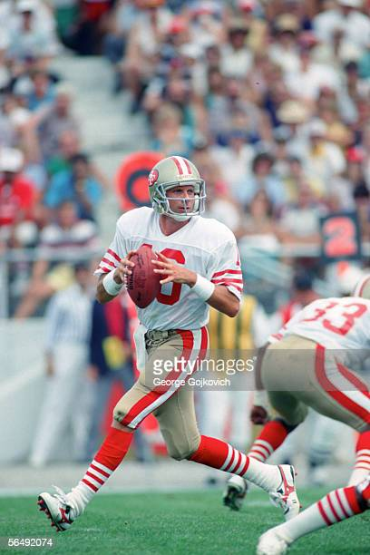 Quarterback Joe Montana of the San Francisco 49ers drops back to pass against the Kansas City Chiefs during a preseason game at Fawcett Stadium at...