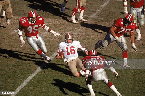 Quarterback Joe Montana of the San Francisco 49ers prepares to slide in front of linebacker Aundray Bruce of the Atlanta Falcons in an NFL game at...