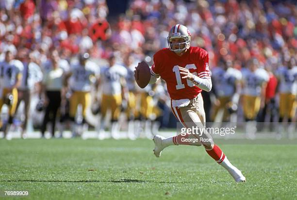 Quarterback Joe Montana of the San Francisco 49ers runs with the ball as he looks downfield for a receiver during a game against the Pittsburgh...