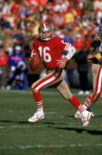 Quarterback Joe Montana of the San Francisco 49ers runs with the ball as he looks down field for a receiver during a game against the Los Angeles...