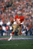 Quarterback Joe Montana of the San Francisco 49ers runs with the ball as he looks downfield for a receiver in Super Bowl XIX against the Miami...