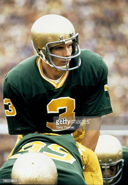Quarterback Joe Montana of the University of Notre Dame Fighting Irish calls out the signals at the line of scrimmage during a game on November 25...