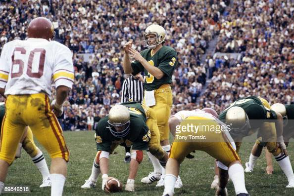 Quarterback Joe Montana of the University of Notre Dame Fighting Irish calls time out at the line of scrimmage during a game on November 25 1978...
