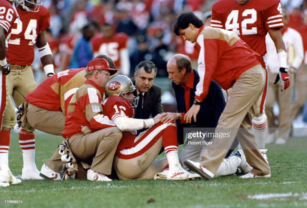 Quarterback Joe Montata #16 of the San Francisco 49ers sits on the ground after Leonard Marshall, defensive lineman for the New York Giants (not pictured), hit Montana during the 1990 - 1991 NFC Championship Game at Candlestick Park (now Monster Park), San Francisco, California, January 20, 1991. Montana left the game due to injuries he suffered from the blind-side sack. The Giants went on to defeat the 49ers 15 to 13, the victory qualifying them for Super Bowl XXV.