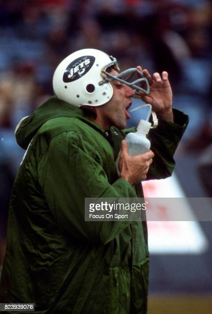 Quarterback Joe Namath of the New York Jets takes a drink of water on the sidelines during an NFL football game circa 1975 at Shea Stadium in the...