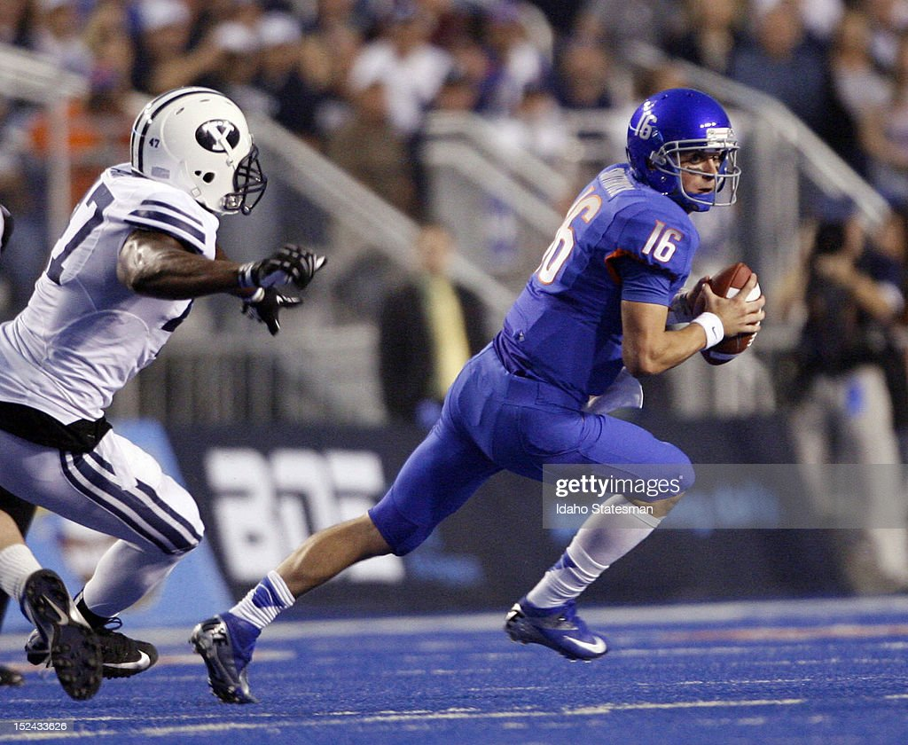 Quarterback Joe Southwick of Boise State evades pressure from Ezekiel Ansah of Brigham Young at Bronco Stadium in Boise Idaho on Thursday September...
