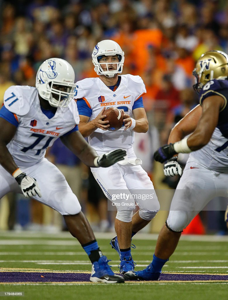 Quarterback <a gi-track='captionPersonalityLinkClicked' href=/galleries/search?phrase=Joe+Southwick&family=editorial&specificpeople=7159939 ng-click='$event.stopPropagation()'>Joe Southwick</a> #16 of the Boise State Broncos drops back to pass against the Washington Huskies on August 31, 2013 at Husky Stadium in Seattle, Washington.
