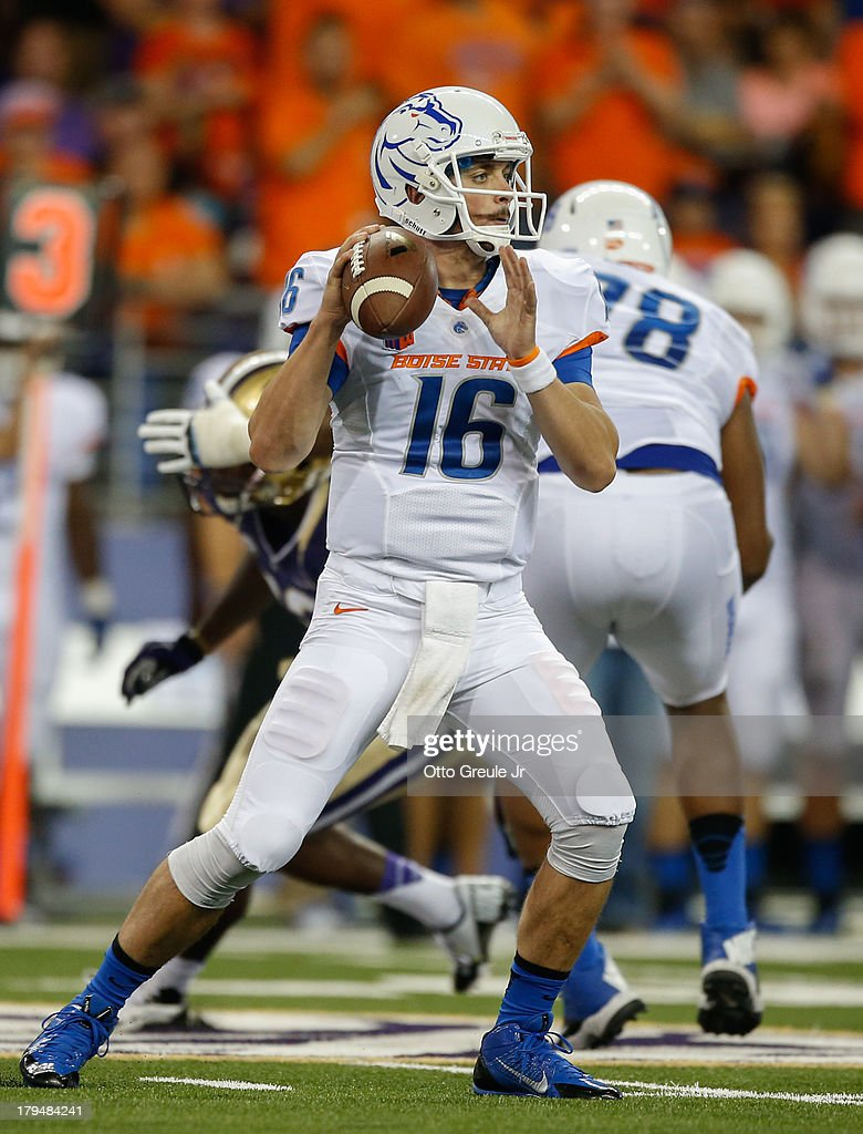 Quarterback <a gi-track='captionPersonalityLinkClicked' href=/galleries/search?phrase=Joe+Southwick&family=editorial&specificpeople=7159939 ng-click='$event.stopPropagation()'>Joe Southwick</a> #16 of the Boise State Broncos looks downfield to pass against the Washington Huskies on August 31, 2013 at Husky Stadium in Seattle, Washington.