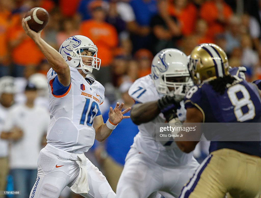 Quarterback <a gi-track='captionPersonalityLinkClicked' href=/galleries/search?phrase=Joe+Southwick&family=editorial&specificpeople=7159939 ng-click='$event.stopPropagation()'>Joe Southwick</a> #16 of the Boise State Broncos passes against the Washington Huskies on August 31, 2013 at Husky Stadium in Seattle, Washington. The Huskies defeated Broncos 38-6.