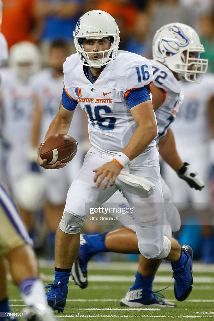 Quarterback <a gi-track='captionPersonalityLinkClicked' href=/galleries/search?phrase=Joe+Southwick&family=editorial&specificpeople=7159939 ng-click='$event.stopPropagation()'>Joe Southwick</a> #16 of the Boise State Broncos rushes against the Washington Huskies on August 31, 2013 at Husky Stadium in Seattle, Washington.