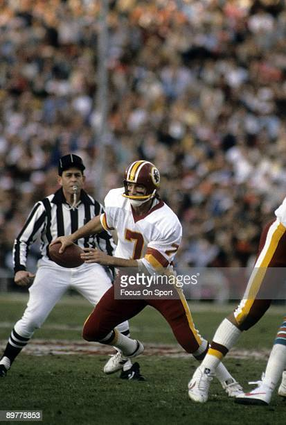 Quarterback Joe Theismann of the Washington Redskins in action runs with the ball against the Miami Dolphins during Super Bowl XVII on January 30...