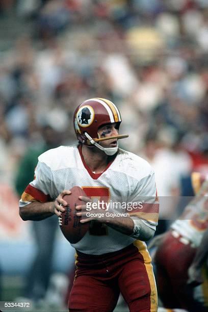 Quarterback Joe Theismann of the Washington Redskins looks to pass at RFK Stadium circa 1983 in Washington DC