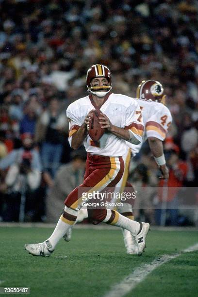 Quarterback Joe Theismann of the Washington Redskins looks to pass against the Miami Dolphins during Super Bowl XVII at the Rose Bowl on January 30...