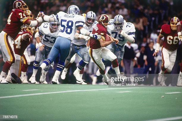 Quarterback Joe Theismann of the Washington Redskins scrambling against the Dallas Cowboys on December 11 l983 in Irving Texas