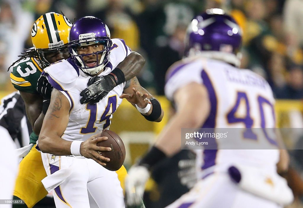 Quarterback <a gi-track='captionPersonalityLinkClicked' href=/galleries/search?phrase=Joe+Webb&family=editorial&specificpeople=5222364 ng-click='$event.stopPropagation()'>Joe Webb</a> #14 of the Minnesota Vikings looks to pass the ball to tight end <a gi-track='captionPersonalityLinkClicked' href=/galleries/search?phrase=Rhett+Ellison&family=editorial&specificpeople=4485159 ng-click='$event.stopPropagation()'>Rhett Ellison</a> #40 as outside linebacker <a gi-track='captionPersonalityLinkClicked' href=/galleries/search?phrase=Erik+Walden&family=editorial&specificpeople=5443480 ng-click='$event.stopPropagation()'>Erik Walden</a> #93 of the Green Bay Packers attempts to sack Webb in the first half during the NFC Wild Card Playoff game at Lambeau Field on January 5, 2013 in Green Bay, Wisconsin.