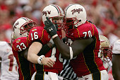 Quarterback Joel Statham of the University of Maryland Terrapins celebrates his 1yard third quarter touchdown with Stephon Heyer and Josh Allen as...