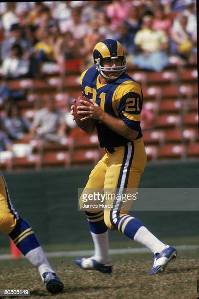 Quarterback John Hadl of the Los Angeles Rams drops back to pass in an NFL game against the Atlanta Falcons at the Los Angeles Memorial Coliseum on...