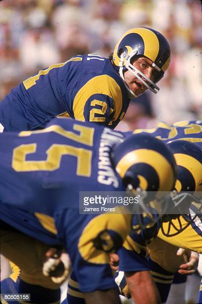 Quarterback John Hadl of the Los Angeles Rams sets the offense in an NFL game against the Green Bay Packers at the Los Angeles Memorial Coliseum on...