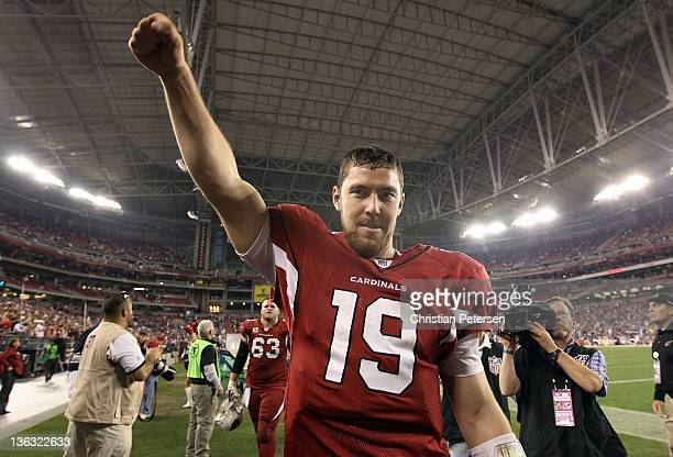 Quarterback John Skelton of the Arizona Cardinals celebrates as he walks off the field after defeating the Seattle Seahawks in overtime of the NFL...
