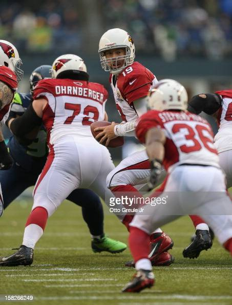 Quarterback John Skelton of the Arizona Cardinals drops back against the Seattle Seahawks at CenturyLink Field on December 9 2012 in Seattle...