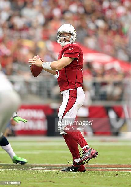 Quarterback John Skelton of the Arizona Cardinals drops back to pass during the season opener against the Seattle Seahawks at the University of...