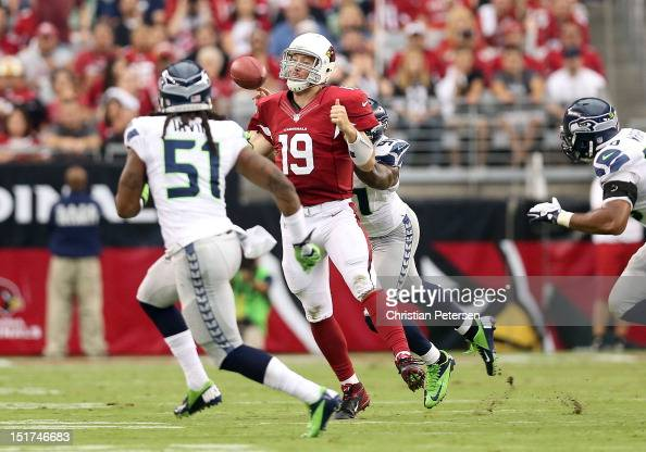 Quarterback John Skelton of the Arizona Cardinals has the football knocked from his hand during the season opener against the Seattle Seahawks at the...