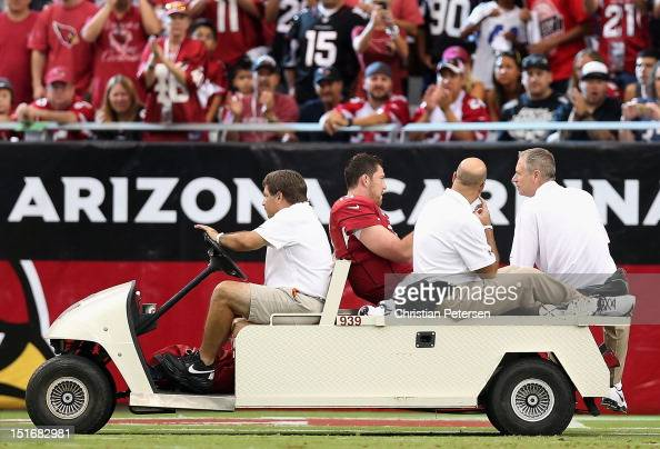 Quarterback John Skelton of the Arizona Cardinals is carted off the field after an injury during the season opener against the Seattle Seahawks at...