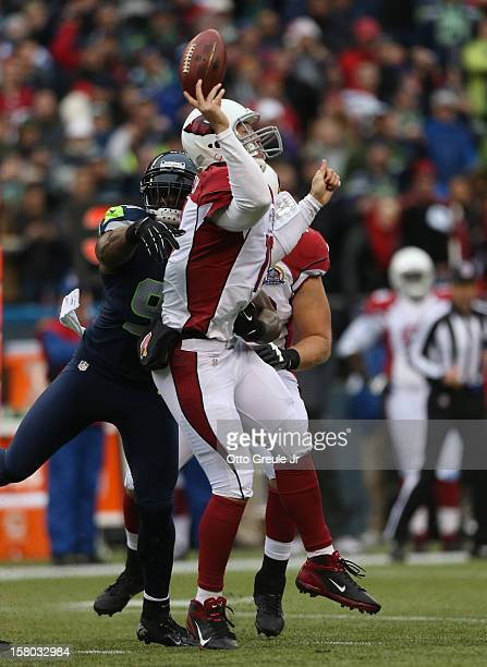 Quarterback John Skelton of the Arizona Cardinals is hit as he throws by defensive end Chris Clemons of the Seattle Seahawks at CenturyLink Field on...