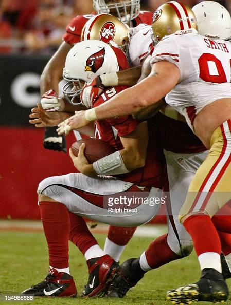 Quarterback John Skelton of the Arizona Cardinals is sacked by Ahmad Brooks and Justin Smith of the San Francisco 49ers during the fourth quarter of...