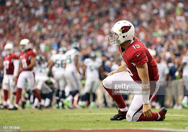 Quarterback John Skelton of the Arizona Cardinals reacts after throwing an interception during the season opener against the Seattle Seahawks at the...