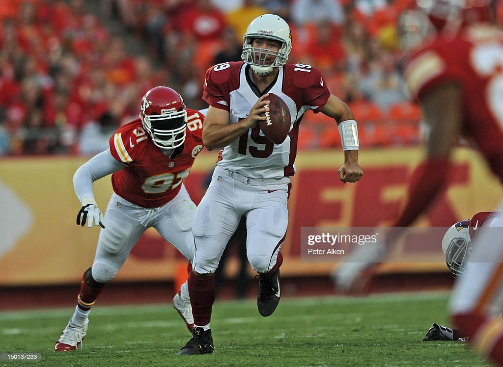 Quarterback John Skelton #19 of the Arizona Cardinals scrambles away from defensive end <a gi-track='captionPersonalityLinkClicked' href=/galleries/search?phrase=Tamba+Hali&family=editorial&specificpeople=630576 ng-click='$event.stopPropagation()'>Tamba Hali</a> #91 of the Kansas City Chiefs during the first half on August 10, 2012 at Arrowhead Stadium in Kansas City, Missouri. Kansas City defeated Arizona 27-17.