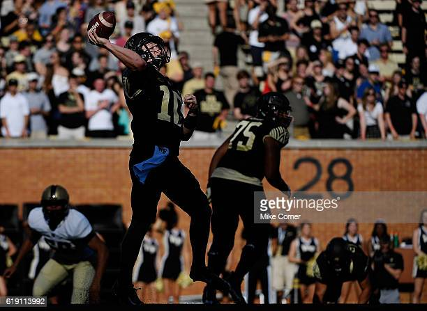 Quarterback John Wolford of the Wake Forest Demon Deacons makes a rushed throw against the Army Black Knights at BBT Field on October 29 2016 in...