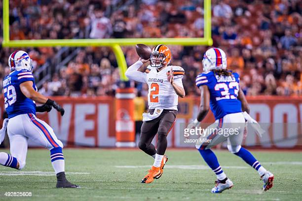 quarterback Johnny Manziel of the Cleveland Browns looks to pass while under pressure from linebacker AJ Tarpley of the Buffalo Bills and cornerback...
