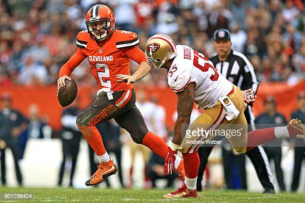 Quarterback Johnny Manziel of the Cleveland Browns runs away from outside linebacker Ahmad Brooks of the San Francisco 49ers during the fourth...