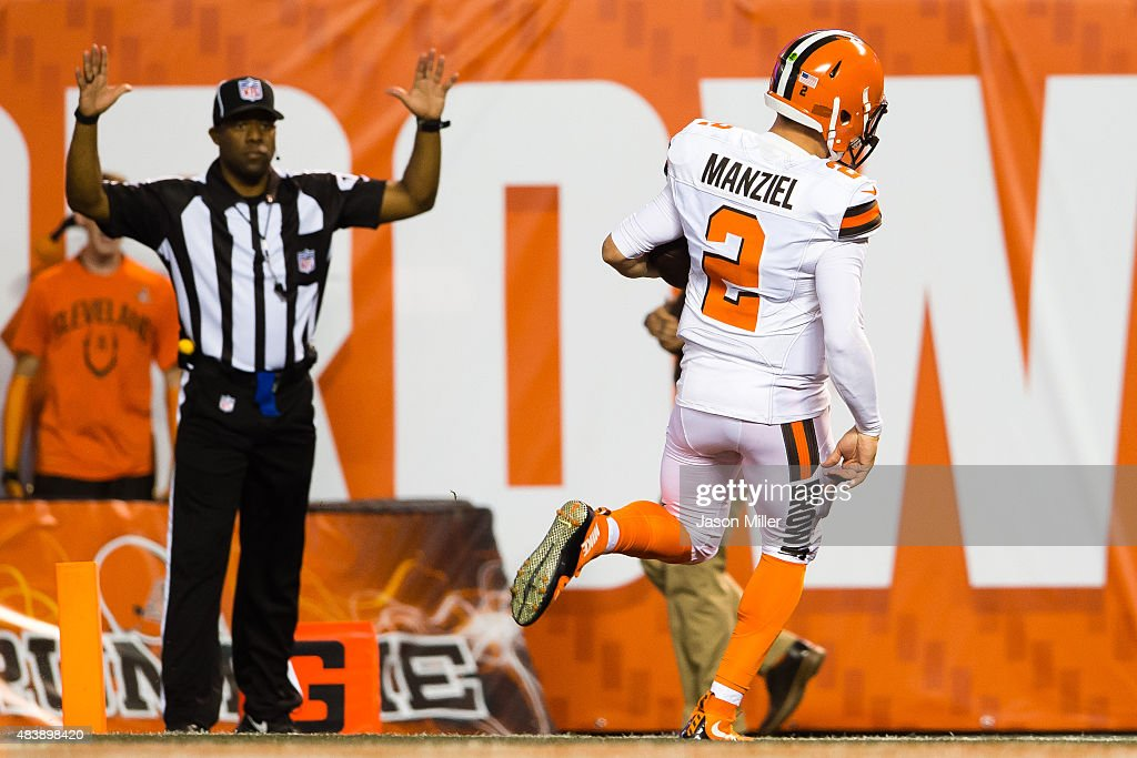 Quarterback <a gi-track='captionPersonalityLinkClicked' href=/galleries/search?phrase=Johnny+Manziel&family=editorial&specificpeople=9703372 ng-click='$event.stopPropagation()'>Johnny Manziel</a> #2 of the Cleveland Browns runs in a touchdown during the first half against the Washington Redskins at FirstEnergy Stadium on August 13, 2015 in Cleveland, Ohio.