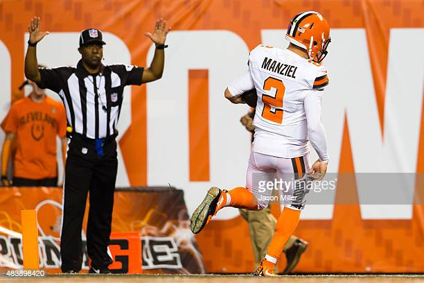 Quarterback Johnny Manziel of the Cleveland Browns runs in a touchdown during the first half against the Washington Redskins at FirstEnergy Stadium...