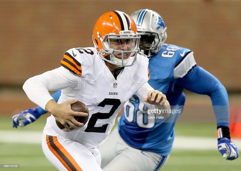 Quarterback <a gi-track='captionPersonalityLinkClicked' href=/galleries/search?phrase=Johnny+Manziel&family=editorial&specificpeople=9703372 ng-click='$event.stopPropagation()'>Johnny Manziel</a> #2 of the Cleveland Browns tries to avoid the tackle by George Johnson #68 of the Detroit Lions in the third quarter during a preseason game at Ford Field on August 9, 2014 in Detroit, Michigan.