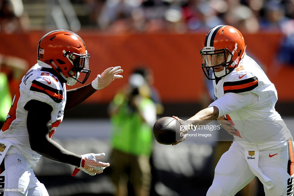 Quarterback <a gi-track='captionPersonalityLinkClicked' href=/galleries/search?phrase=Johnny+Manziel&family=editorial&specificpeople=9703372 ng-click='$event.stopPropagation()'>Johnny Manziel</a> #2 of the Clevleand Browns hands off to running back <a gi-track='captionPersonalityLinkClicked' href=/galleries/search?phrase=Duke+Johnson+-+Giocatore+di+football+americano&family=editorial&specificpeople=13981151 ng-click='$event.stopPropagation()'>Duke Johnson</a> #29 during a game against the Tennessee Titans on September 20, 2015 at FirstEnergy Stadium in Cleveland, Ohio. Cleveland won 28-14.