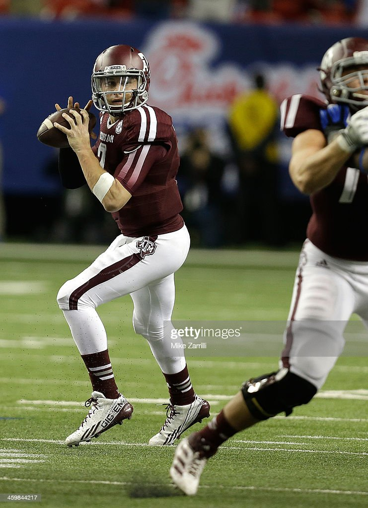 Quarterback <a gi-track='captionPersonalityLinkClicked' href=/galleries/search?phrase=Johnny+Manziel&family=editorial&specificpeople=9703372 ng-click='$event.stopPropagation()'>Johnny Manziel</a> #2 of the Texas A&M Aggies drops back to pass during the Chick-fil-A Bowl game against the Duke Blue Devils at the Georgia Dome on December 31, 2013 in Atlanta, Georgia.
