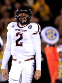 Quarterback Johnny Manziel of the Texas AM Aggies reacts after the Aggies failed to convert on a third down play during the game against the Missouri...
