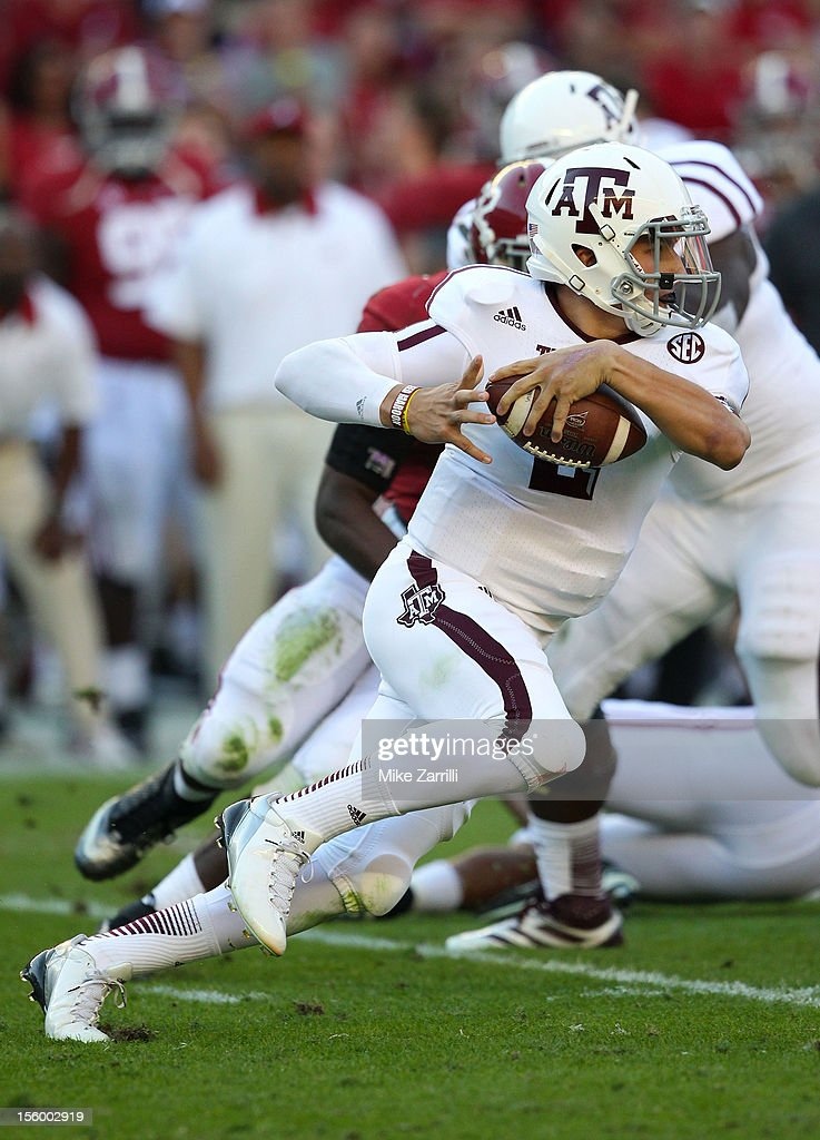 Quarterback <a gi-track='captionPersonalityLinkClicked' href=/galleries/search?phrase=Johnny+Manziel&family=editorial&specificpeople=9703372 ng-click='$event.stopPropagation()'>Johnny Manziel</a> #2 of the Texas A&M Aggies runs and looks downfield during the game against the Alabama Crimson Tide at Bryant-Denny Stadium on November 10, 2012 in Tuscaloosa, Alabama.