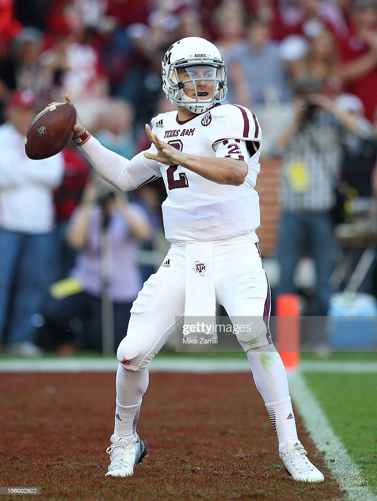 Quarterback <a gi-track='captionPersonalityLinkClicked' href=/galleries/search?phrase=Johnny+Manziel&family=editorial&specificpeople=9703372 ng-click='$event.stopPropagation()'>Johnny Manziel</a> #2 of the Texas A&M Aggies throws a pass during the game against the Alabama Crimson Tide at Bryant-Denny Stadium on November 10, 2012 in Tuscaloosa, Alabama.