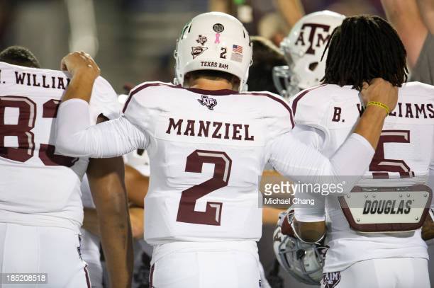 Quarterback Johnny Manziel of the Texas AM Aggies with teammates defensive lineman Alonzo Williams and running back Brandon Williams before their...