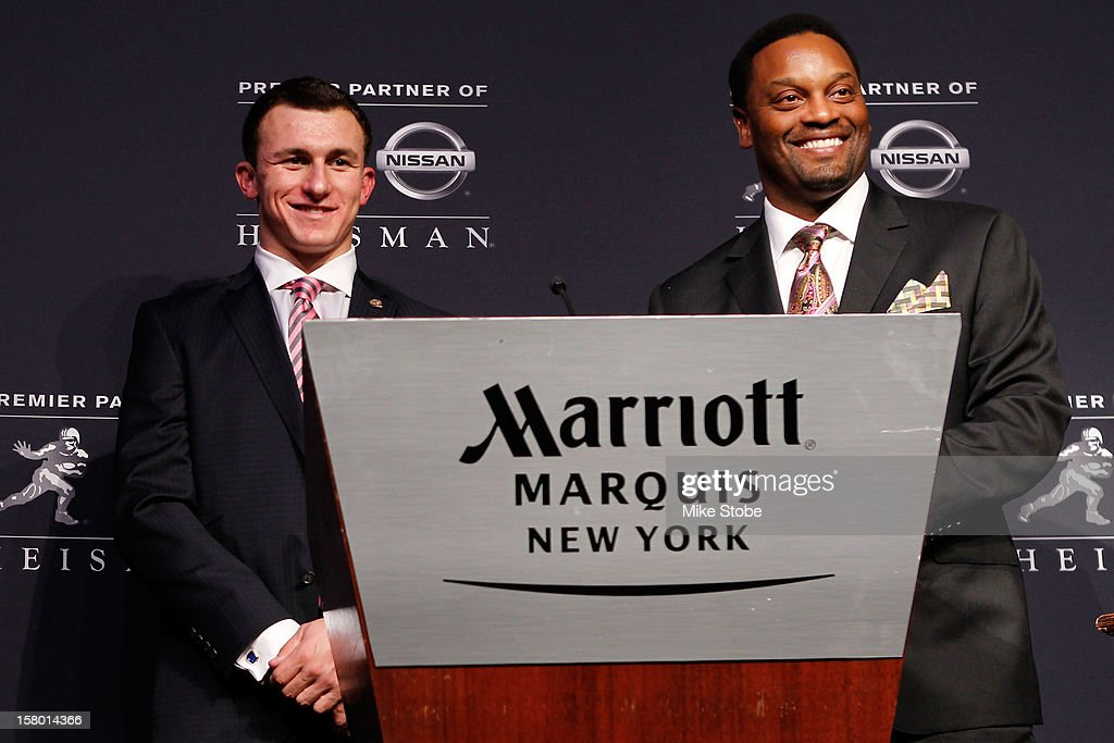 Quarterback Johnny Manziel of the Texas A&M University Aggies and head coach Kevin Sumlin pose after being named the 78th Heisman Memorial Trophy Award winner at a press conference at the Marriott Marquis on December 8, 2012 in New York City.