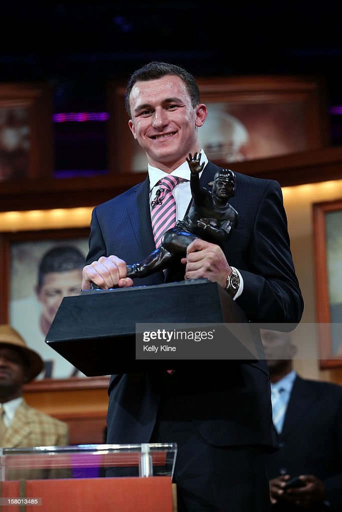 Quarterback <a gi-track='captionPersonalityLinkClicked' href=/galleries/search?phrase=Johnny+Manziel&family=editorial&specificpeople=9703372 ng-click='$event.stopPropagation()'>Johnny Manziel</a> of the Texas A&M University Aggies poses with the Heisman Memorial Trophy after being named the 78th Heisman Memorial Trophy Award winner at the Best Buy Theater on December 8, 2012 in New York City.