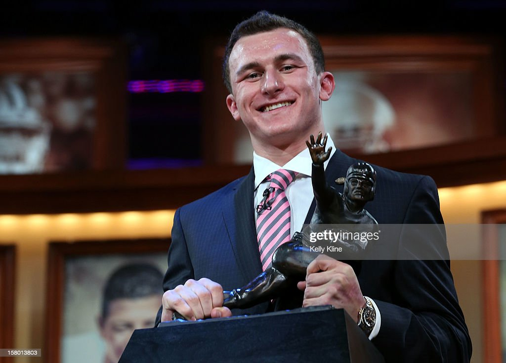Quarterback Johnny Manziel of the Texas A&M University Aggies poses with the Heisman Memorial Trophy after being named the 78th Heisman Memorial Trophy Award winner at the Best Buy Theater on December 8, 2012 in New York City.