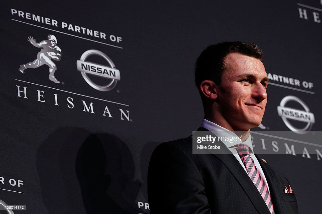 Quarterback Johnny Manziel of the Texas A&M University Aggies speaks after being named the 78th Heisman Memorial Trophy Award winner at a press conference at the Marriott Marquis on December 8, 2012 in New York City.