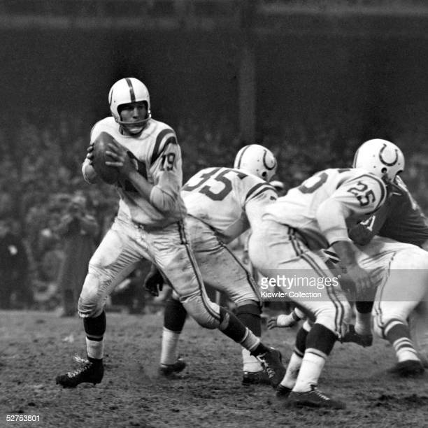 Quarterback Johnny Unitas of the Baltimore Colts drops back to pass during the NFL Championship Game on December 28 1958 against the New York Giants...
